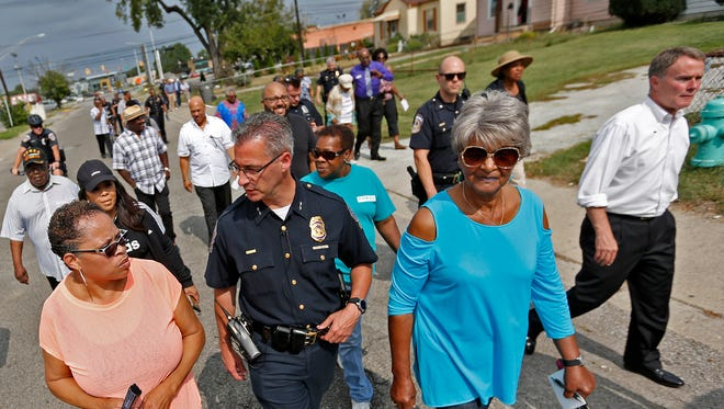 IMPD Chief of Police Bryan Roach, center, and Mayor Joe Hogsett, right, join others during a community walk, Wednesday, Sept. 27, 2017.