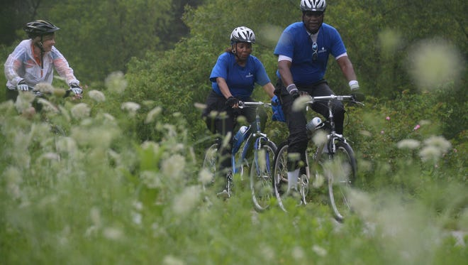 Cyclists ride along the Cardinal Greenway in this file photo.