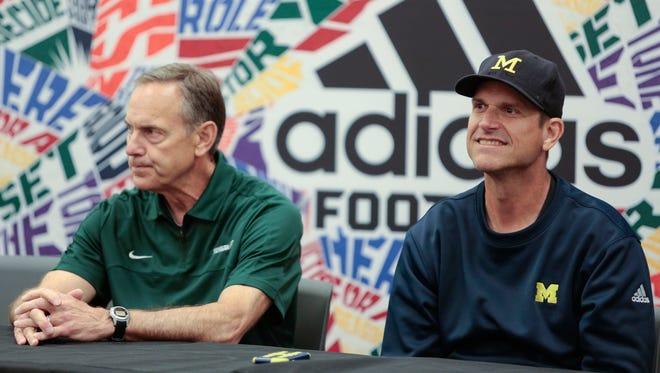 MSU football coach Mark Dantonio, left, and U-M football coach Jim Harbaugh at Sound Mind Sound Body.