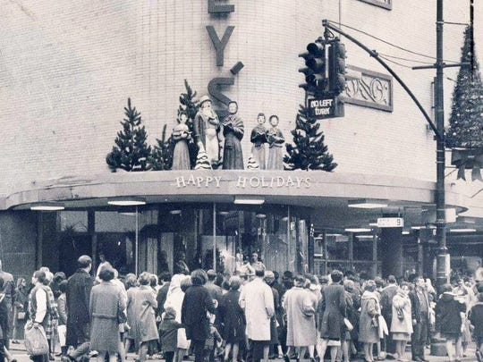 Shoppers congregate in the area of Penney's department store on Fourth Street on Nov. 24, 1967, after Thanksgiving.  Figures of carolers and a 'Happy Holidays' message decorate the entrance.