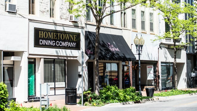 Storefronts in the 700 block of East Main Street, including Hometowne Dining Co. and Secret Ingredient, in downtown Richmond are seen Tuesday, May 8, 2018.