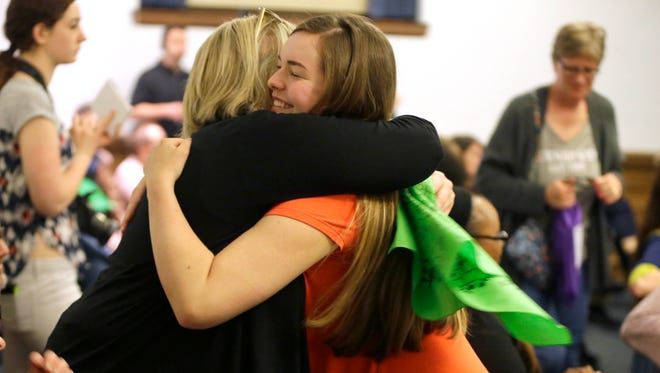 Barrett Poetker gets a hug from an audience member after sharing her story at a storytelling event for USA TODAY NETWORK-Wisconsin's Kids in Crisis series on youth mental health.