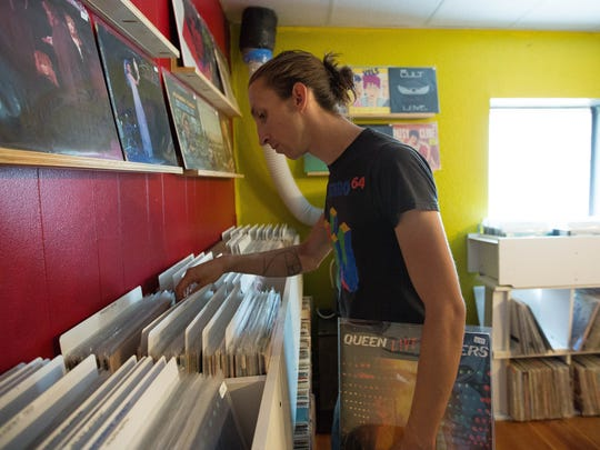 Timothy Wilbur, looking through stacks of records at the downtown location of Eyeconik Records, Thursday, August 23, 2018.