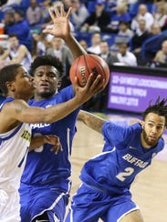 Delaware's Kevin Anderson (left) drives against Buffalo's