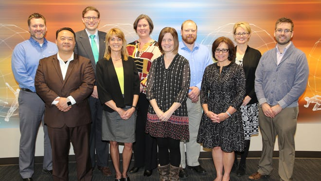 The first graduating class of the Non-Profit Leadership Institute includes (front row, from left) Bee Yang, Denise Martinez, Jennie Moore, Hillary Armstrong and (back row, from left) JJ Schauske, Kristopher Ulrich, Maren Peterson, Michael Green, Kelly Nutty and Jarrad Bittner. Not pictured is Rosangela Berbert .