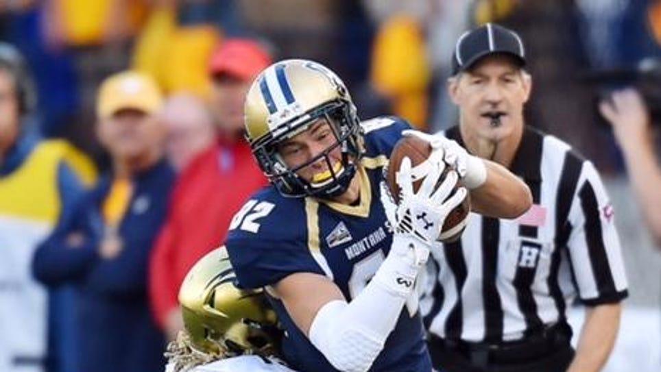 Montana State receiver Mitchell Herbert tries to shake