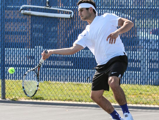 Hammonton's Vincent Maimone returns a serve during