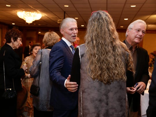 Clay Allen, left, greets guests before accepting the Civic Cup Award for his civic and charitable work, in Lafayette Nov. 11, 2016.