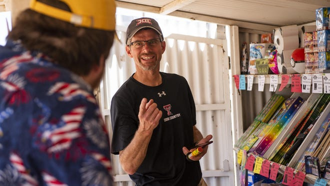 Jon Murray helps a customer at the Mr. W fireworks stand on US Highway 62 in Lubbock County on Monday, June 29, 2020.