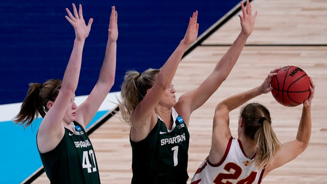 Iowa State guard Ashley Joens (24) is pressured by Michigan State guards Julia Ayrault (40) and Tory Ozment (1) during the first half of a college basketball game in the first round of the women's NCAA tournament at the Alamodome in San Antonio, Monday, March 22, 2021. (AP Photo/Charlie Riedel)