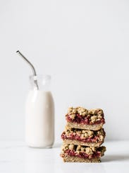 """These strawberry oat crumble bars from """"Oh She Glows"""