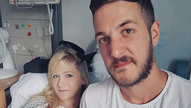 This is an undated hand out photo of Chris Gard and Connie Yates with their son Charlie Gard provided by the family, at Great Ormond Street Hospital, in London.