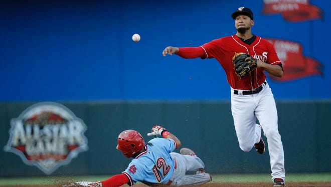 Chihuahuas shortstop Jose Rendon picks up the double play during action in their fifth game of the series.