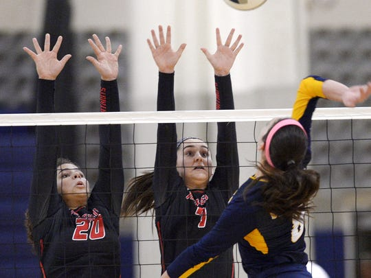 Penfield's Beth Lawatsch, middle, is a big part of everything the Patriots do. She and Sarah Green are trying to block Victor's Amanda Dake in this picture.