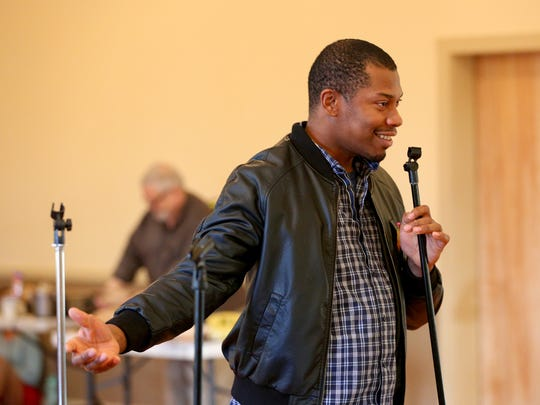 "Brian Demar Jones, as Wally Ferguson, is seen during a rehearsal of ""The 1940's Radio Hour"" by  Enlightened Theatrics."