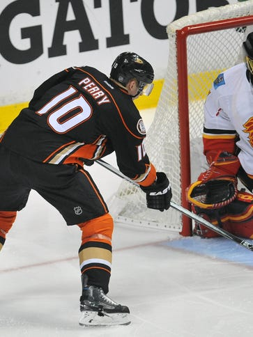 Ducks right wing Corey Perry scores against  Calgary