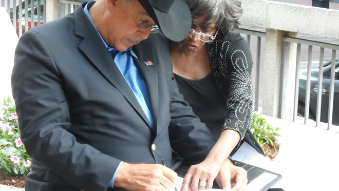 Russel Honoré, a retired Army lieutenant general now working on environmental causes, talks to Agnes Francisco of the Alexandria/Pineville Community Focus Project on Tuesday outside Alexandria City Hall before speaking to councilmen about the health impact of local creosote plants.