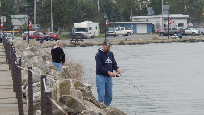 Anglers fish off the pier at Waterworks Park in Port Clinton.