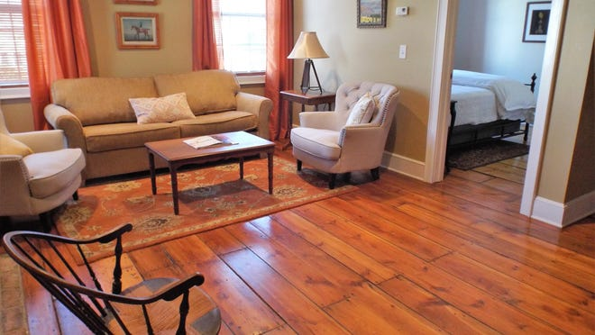 Original wide-plank wood flooring from the 1840s is featured in the Mashomack bedroom suite at The Inn at Pine Plains. When this room and the inn's other guest rooms aren't in use, they're kept at a cool 55 to 60 degrees to help conserve heat.