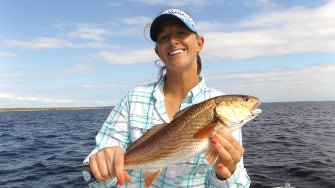 Heather Tucker with her first-ever redfish. She caught it while fishing with Capt. Pat McGriff off Keaton Beach.