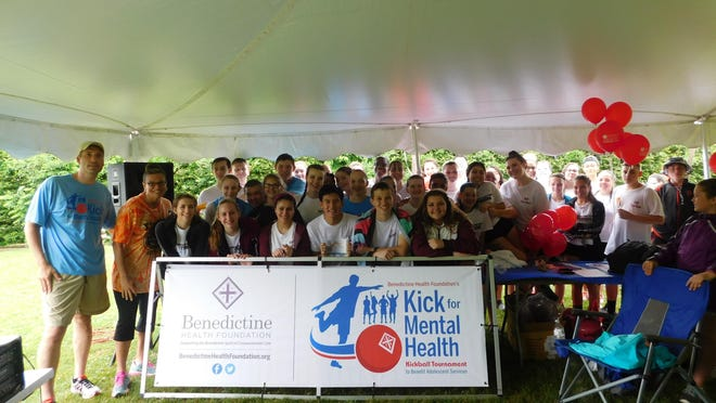 Paul Beichert, Kick for Mental Health co-chair; Amy Kapes, Kingston High School Social Worker and Kingston High School Kickball Team Members.