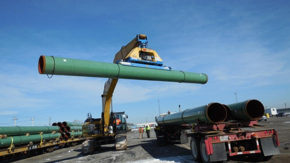 Pipes for the Constitution Pipeline are stacked at