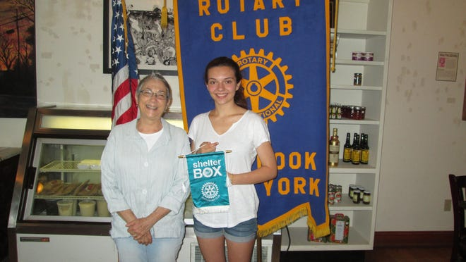 Rotary immediate past president Susan Simon presented the ShelterBox Hero award to Interact co-president Abby Foster.