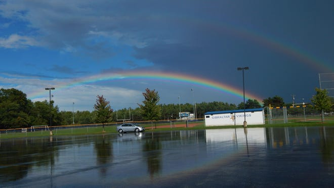 A double rainbow appears over Gibraltar School after a storm Monday, the day after two people – including a Gibraltar senior – were killed in a plane crash in Peninsula State Park.