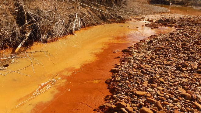 Sludge from heavy metals accumulates in Belt Creek. Coulees transport run-off into the creek from an abandoned coal mine.