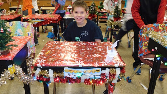 Martin Luther School third-grade student Ryland Lapean and his classmates recently worked on their art project for the day: decorating their desks for Christmas.