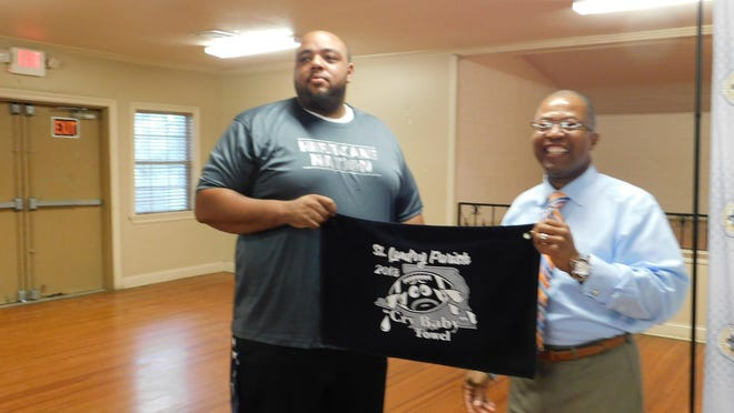 North Central head football coach Jacobi Thierry accepts the annual crying towel presented to the St. Landry Parish public school coach who spins the saddest preseason story about his team. Superintendent Patrick Jenkins presented the award to Thierry during Tuesday night's jamboree meeting that included all parish public school coaches and administrators.
