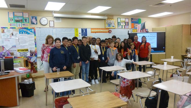 Seventh-graders in the Spanish for Spanish Speakers class at Palm Springs Middle and school staff celebrated the community's Hispanic culture.