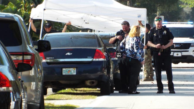 Police investigate an officer-involved shooting Thursday in Ormond Beach. Five officers shot and killed a man and a woman in the 800 block of Beach Street.