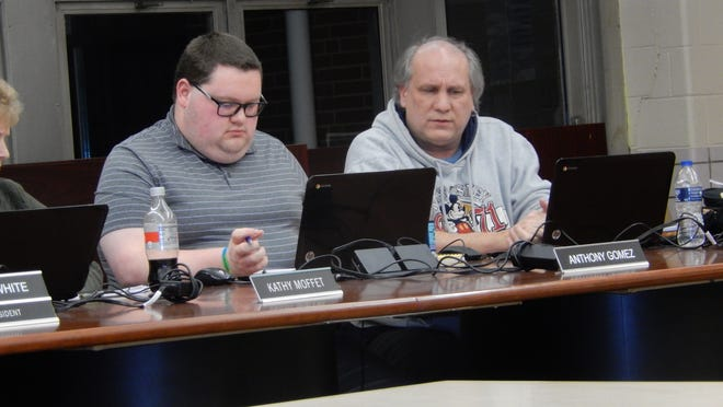From left, Cuyahoga Falls Board of Education members Anthony Gomez and Dave Martin review information during a board meeting in 2019. Martin on Monday, Aug. 10, announced he was resigning from the board effective Aug. 11.