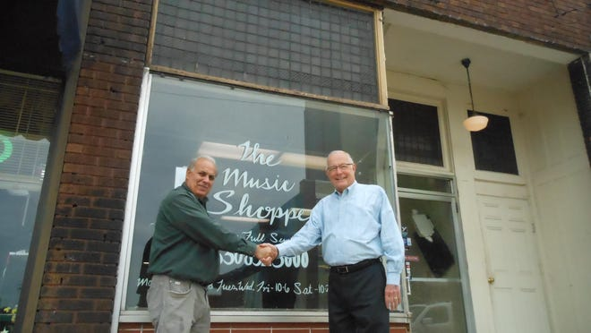 Phillip Elum (left), volunteer director of Massillon Main Street, and Mel Herncane, executive director of the Massillon Development Foundation, are pictured outside of a vacant building at 46 Erie St. N. The business organizations are engaged in a joint effort to rehab and sell the building to help boost downtown development.