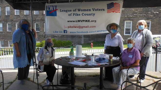 League of Women Voters of Pike County (Pa.) helped mark the 100th anniversary of the 19th Amendment to the Constitution giving women nationwide the right to vote, by giving out voter registration packets, August 30. Set up at the Cocoon in Hawley, from left are: Liz Forrest, Marion Keegan, Carol Comando, Jane Neufeld and Bonnie Samuelson.TCI photo by Peter Becker