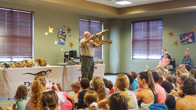 Dinosaur George visits partons at the Bee Cave Public Library in 2019.