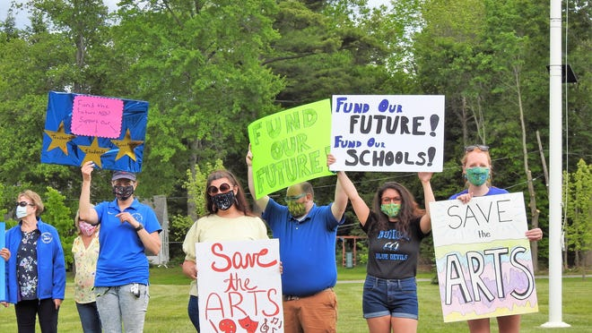 The Winchendon Teachers' Association is becoming a driving force in getting the word out about staff cuts and funding for the school district. Here they are during a recent rally as voters came to cast their ballots in the town election.