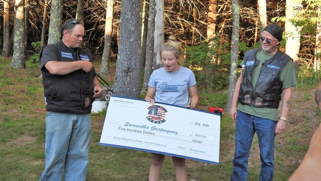 """Samantha Gastonguay of Ashburnham is surprised to receive the James """"Digger"""" Ringquist Scholarship delivered by escort. From left are Patriots Riders of America Chapter 3 President Neil Goguen, Gastonguay and club Vice President Jack McGrath."""
