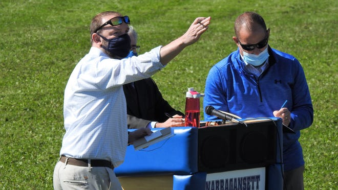 Templeton Selectman Michael Currie, left, and Superintendent Chris Casavant counted votes during the district-wide school budget meeting held on the game field outside Narragansett Middle School on Sept. 19.