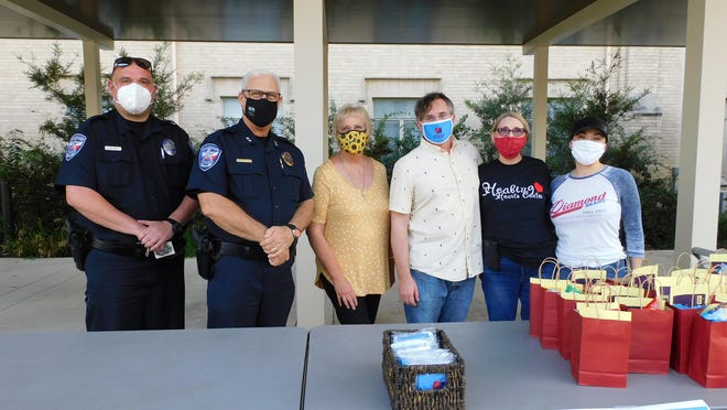 National Night Out at UMC, from left, Officer O.T. Glidewell, Chief Wade Goolsby and church volunteers take part in the event Oct. 6.
