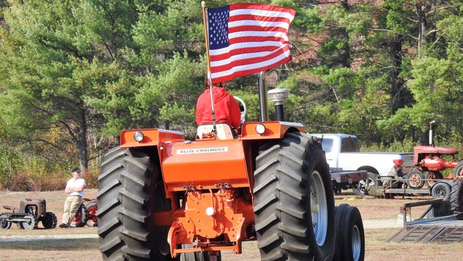 Flags and tractors are a natural mix.