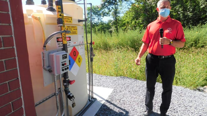 DPW Director David Field standing in front of the Bioxide tank at the new pump station.