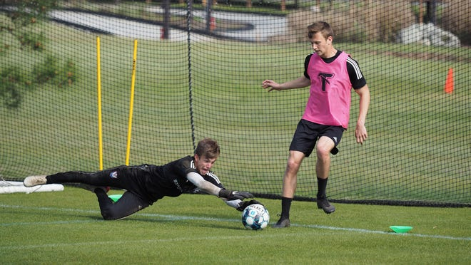 Tormenta FC goalkeeper Stephen O'Hearn, who attends Savannah Arts Academy, gets to the ball first during practice.