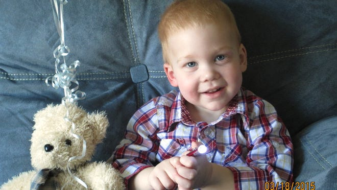 Gardell Martin, 22 months, sits at his home in Mifflinburg, Pa., on Saturday. His body, pulled from an icy creek, was revived after an hour and 41 minutes of CPR. He has suffered virtually no lingering effects.