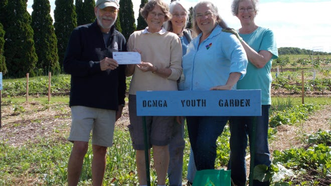 The Door County Community Foundation recently awarded the Door County Master Gardener Association a sustainability grant from the Children and Youth Fund to support the Youth Spring Planting Program. This hands-on learning program introduces third- and fourth-grade students to the importance of homegrown produce. From left are Frank Maxwell, board member of the Door County Community Foundation; Deborah Javurek, Youth Program co-chair; Kathy Green, Kathie Vavra, Youth Program co-chair and president of the Door County Master Gardeners; and Lee Somerville.