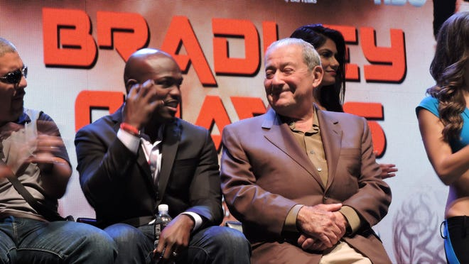 Bob Arum, right, sits with boxer Timothy Bradley during his news conference in 2014.