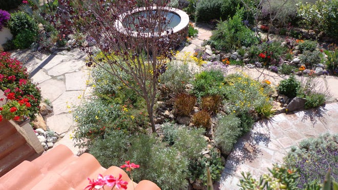 A rare two story Palm Springs home utilizes the bird's-eye view of its well designed garden.