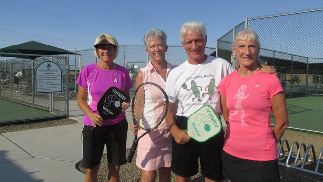 Sunland Springs Village residents (from left) Gale Sabatino, Linda McAteer and siblings Roy Brandli and Ila Brandli are typical of many active residents in the Mesa adult community.