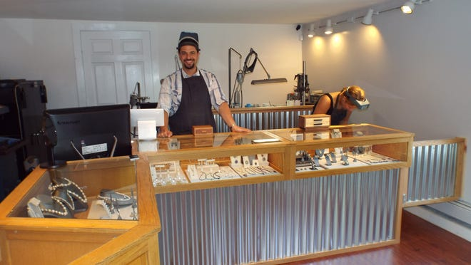 The retail space at Hudson Valley Goldsmith in New Paltz has an open view of the shop's work area behind the display counter. Owner and jewelry designer, David Walton, left, uses recycled and reclaimed materials for his jewelry. Also pictured is Cathy Jasterzbski, a senior studying art education and metals at SUNY New Paltz, who works part-time as a jeweler at the shop.